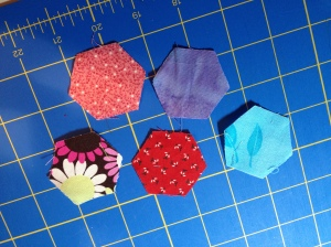 various scraps cut into hexies