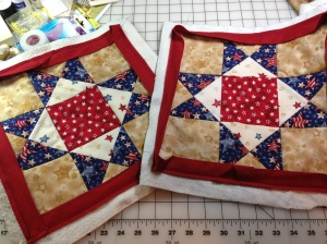 "Ohio Star blocks 12.5"" quilted and bound.  Just hand stitching left."
