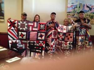 Veterans and their wives receiving their quilts
