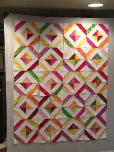quilt on design wall - time to sew it together